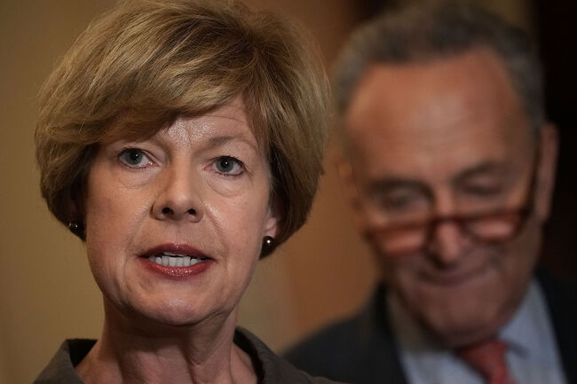 WASHINGTON, DC - OCTOBER 10: U.S. Sen. Tammy Baldwin (D-WI) speaks as Senate Minority Leader Sen. Chuck Schumer (D-NY) listens during a news briefing after a weekly Senate Democratic policy luncheon October 10, 2018 at the U.S. Capitol in Washington, DC. Senate Democrats held a policy luncheon to discuss the Democratic agenda. (Photo by Alex Wong/Getty Images)