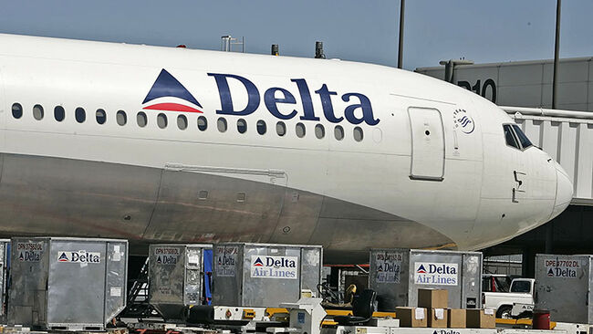 A Delta Airlines jet is prepared for flight