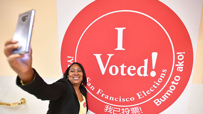 A woman takes a selfie after voting at City Hall in San Francisco, California on November 6, 2018