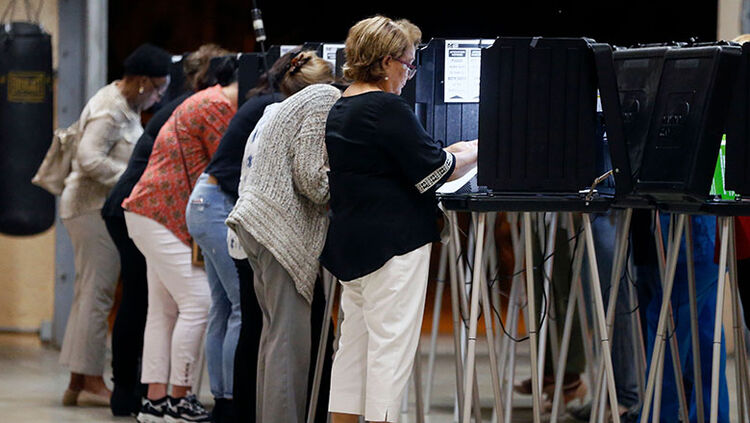 People vote at a polling station in Miami, Florida, on November 6, 2018.