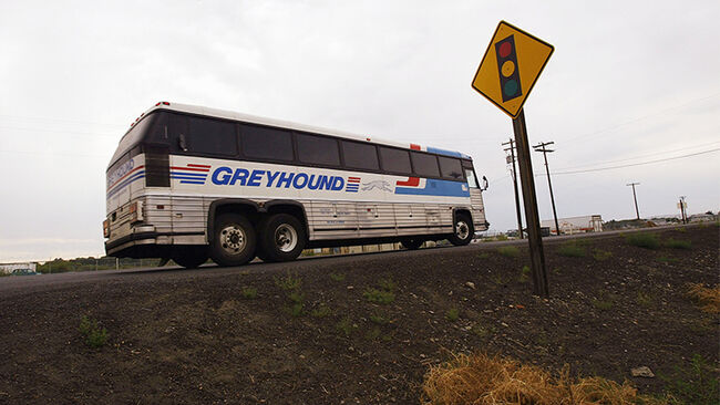 A Greyhound bus pulls out of a driveway of a diner in rural Washington state