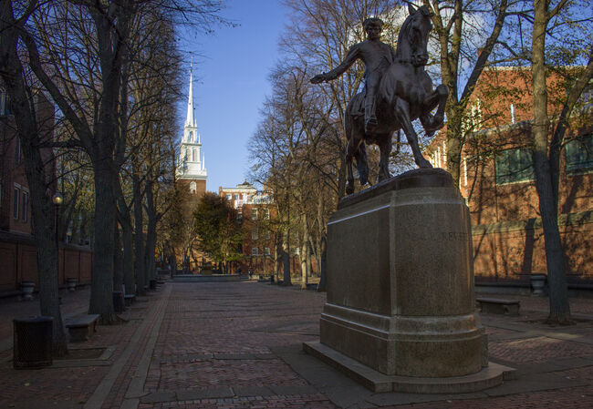 Paul Revere Mall, Boston, USA Winter view of Paul Revere Monument on the Paul Revere Mall (Prado) in the historic North End neghborhood of Boston, Massachusetts, USA. Old North Church, where the American Revolution started, can be seen in the background. These sites are located on the Freedom Trail in Boston National Historic Park.
