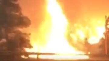 Weird News - Woman Captures Dramatic Video While Driving Through Flames in Malibu