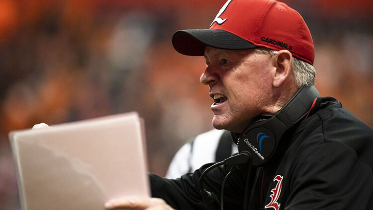 Head coach Bobby Petrino of the Louisville Cardinals disputes a call during the first quarter against the Syracuse Orange at the Carrier Dome