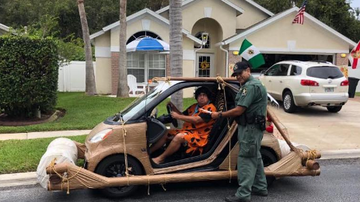 kelly - Man gets pulled over driving 'footmobile' dressed as Fred Flintstone