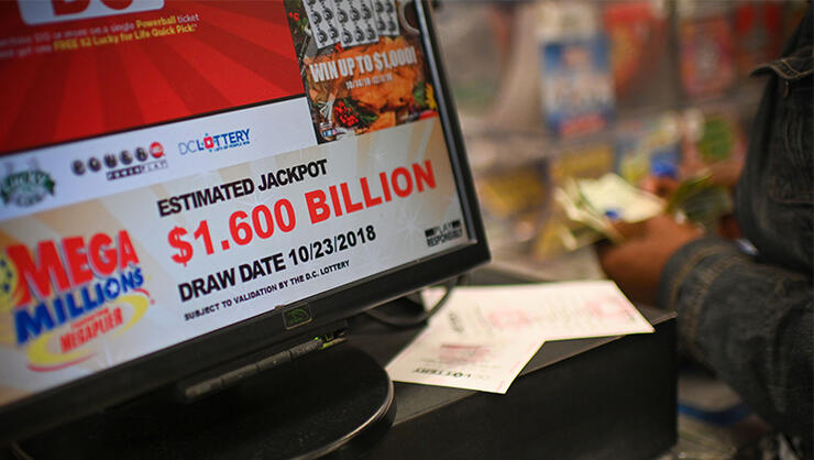 A woman buys Mega Millions tickets hours before the draw of the $1.6 billion jackpot, at a liquor store in Downtown Washington DC