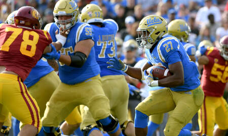 Sports News - Joshua Kelley Goes For Almost 300 Yards In Win Vs. USC