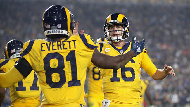 Quarterback Jared Goff #16 of the Los Angeles Rams celebrates a touchdown by teammate Gerald Everett #81 during the fourth quarter of the game against the Kansas City Chiefs at Los Angeles Memorial Coliseum