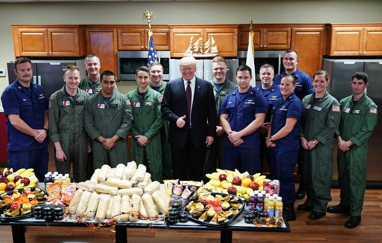 US President Donald Trump poses as he visits with personnel at US Coast Guard Station Lake Worth Inlet in Riviera Beach, Florida, on Thanksgiving Day, November 22, 2018.  (Photo credit MANDEL NGAN/AFP/Getty Images)