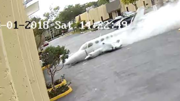 Chuck Dizzle - Video Catches Small Airplane As It Crashes Into Warehouse