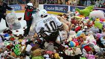 Dino - Teddy Bear Toss at Hockey Game Will Make you CRY