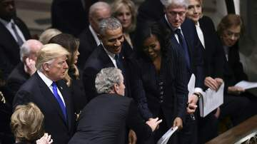 The Bushman Show - George Bush Hands Michelle Obama Candy At Funeral