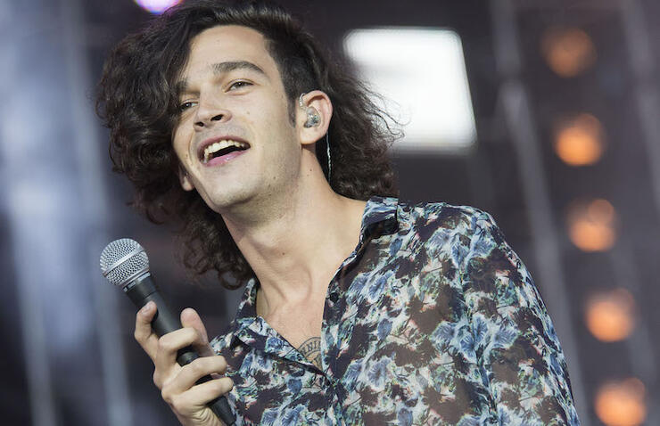 Matty Healy Protests Dubai's Anti-LGBTQ Laws By Kissing Male Fan At Show   iHeartRadio