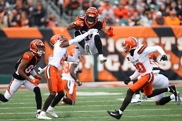 CINCINNATI, OH - NOVEMBER 25: Denzel Ward #21 of the Cleveland Browns attempts to tackle Joe Mixon #28 of the Cincinnati Bengals during the third quarter at Paul Brown Stadium on November 25, 2018 in Cincinnati, Ohio. (Photo by John Grieshop/Getty Images)