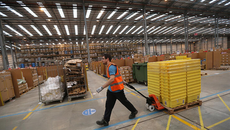 Employees select and dispatch items in the huge Amazon 'fulfilment centre' warehouse