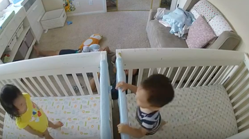 JB - Twin Babies in Cribs Give Each Other Kisses