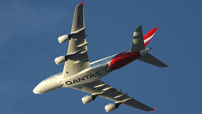 Qantas Airbus A380 in the 'Silver Roo' livery is seen flying over Sydney