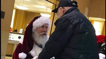 Holidays - Santa Claus Takes A Knee To Thank World War II Veteran