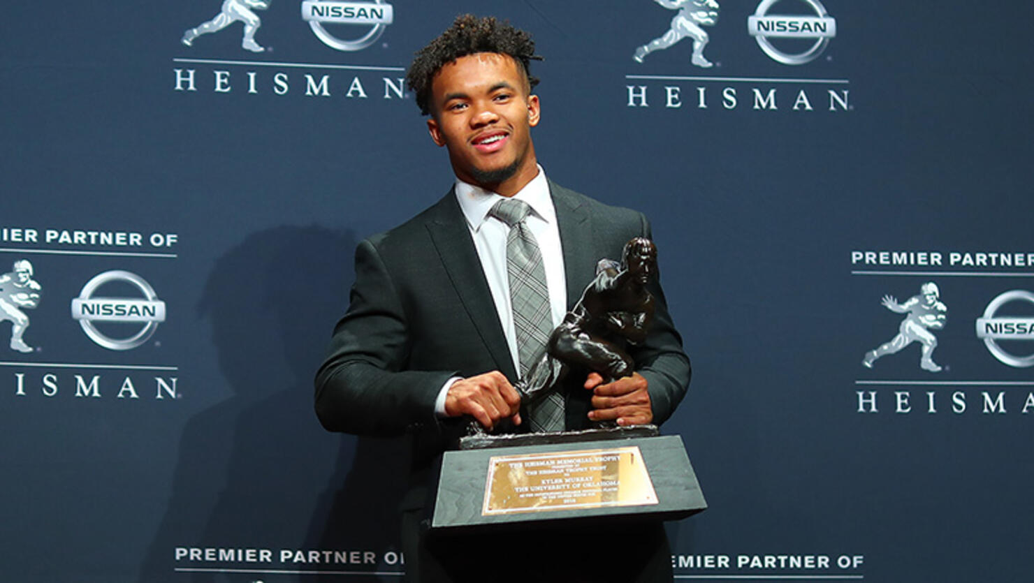 Oklahoma quarterback Kyler Murray poses for photos after winning the 84th Heisman Trophy