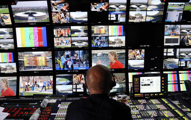 An employee of German television broadcaster ZDF sits at his post in front of monitors in an outside broadcast van at the Olympic Stadium during the 2009 IAAF Athletics World Championships on August 19, 2009 in Berlin. AFP PHOTO DDP / THOMAS LOHNES (Photo credit should read THOMAS LOHNES/AFP/Getty Images)