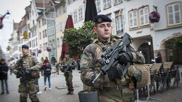 National News - Manhunt Continues For French Christmas Market Gunman