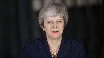 National News - British Prime Minister Theresa May Survives No-Confidence Vote