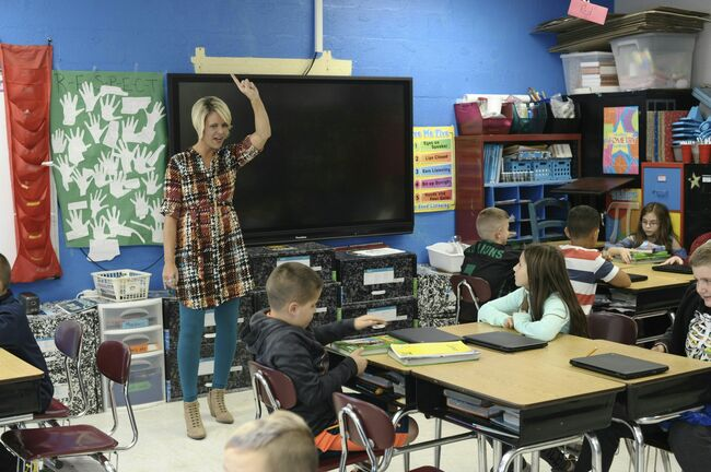 Amy Grady, who is running as an independent for a seat in the West Virginia state Senate, teaches in her classroom at Leon Elementary October 18, 2018 in Leon, West Virginia. - Teachers like Amy Grady successfully went on strike this year across West Virginia demanding better health care and higher pay, and now she hopes to give state legislators a lesson, by winning a state senate seat. With labor activism catching fire and spreading to multiple US states, a record number of teachers -- 1,455 current and former educators, according to the National Education Association -- are running for office in the November 6 midterm elections. (Photo by MICHAEL MATHES / AFP) / With AFP Story by Michael MATHES: From picket lines to polls, US teachers eye political office (Photo credit should read MICHAEL MATHES/AFP/Getty Images)