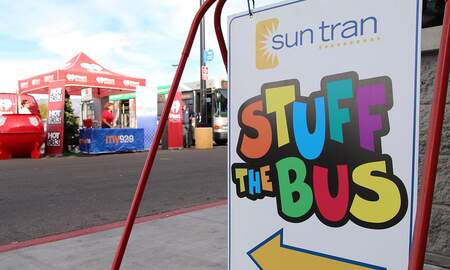 Tucson Happenings - Tucson Helps Stuff The Bus