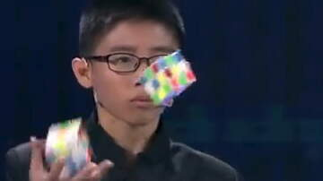Hitman - Kid Solves Rubik's Cubes WHILE JUGGLING!