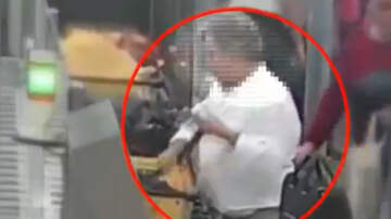 National News - Man Filmed Stealing Thousands Of Dollars From Tray At Airport Security