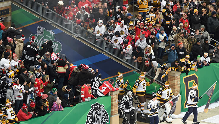 The Boston Bruins and the Chicago Blackhawks walk on to the field to play in the 2019 Bridgestone NHL Winter Classic at Notre Dame Stadium