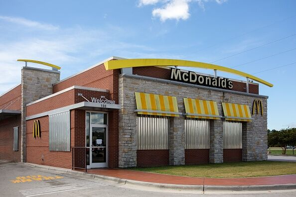 US-WEATHER-ENVIRONMENT-HURRICANE A McDonald's fast food restaurant is fitted with corrugated metal shutters as it sits empty in Cedar Point, North Carolina on September 12, 2018 in advance of Hurricane Florence. - Hurricane Florence churned across the Atlantic Ocean on Wednesday packing winds of 130 miles per hour (215 kph) as an emergency management official warned the monster storm would deliver a 'Mike Tyson punch' to the Carolina coast. President Donald Trump urged residents to heed orders to evacuate and said the federal government was 'ready for the big one that is coming.' (Photo by Logan Cyrus / AFP) (Photo credit should read LOGAN CYRUS/AFP/Getty Images)