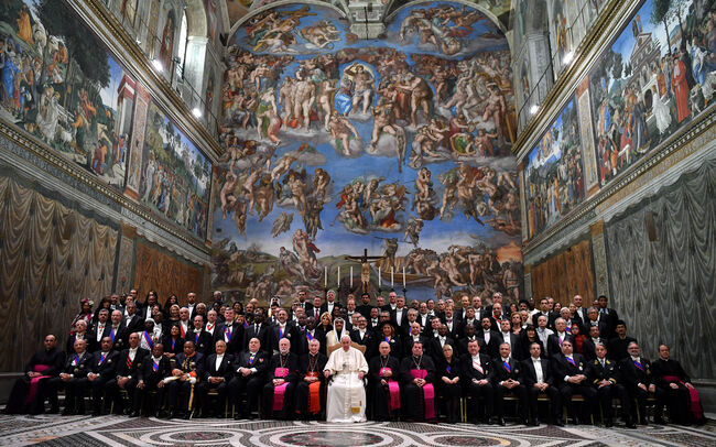 Pope Francis (C) poses in the Sistine Chapel with Members of the Diplomatic Corps accredited to the Holy See, at the end of the audience for the traditional exchange of New Year greetings, at the Vatican on January 7, 2019. (Photo by Ettore FERRARI / POOL / AFP) (Photo credit should read ETTORE FERRARI/AFP/Getty Images)