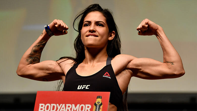 Polyana Viana of Brazil poses on the scale during the UFC 227 weigh-in inside the Orpheum Theater