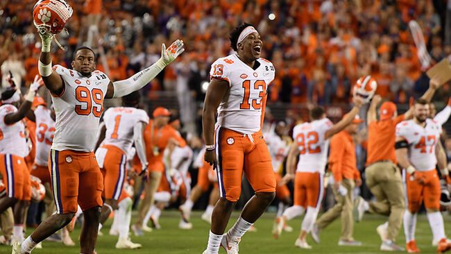 James Edwards #95 and Hunter Renfrow #13 of the Clemson Tigers celebtate their teams 44-16 win over the Alabama Crimson Tide in the CFP National Championship presented by AT&T at Levi's Stadium
