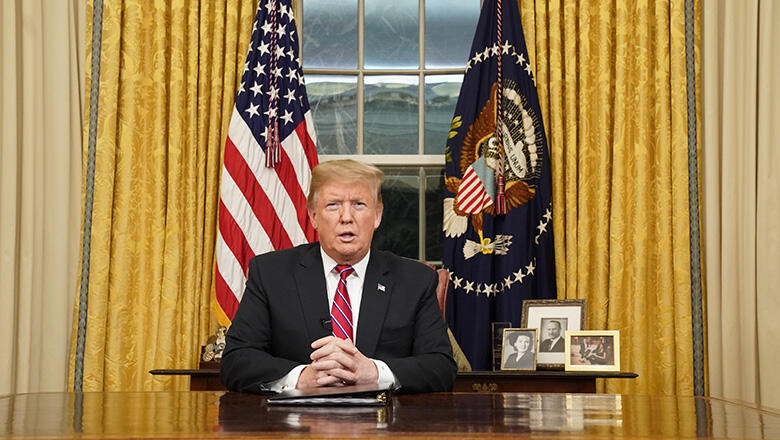 U.S. President Donald Trump speaks to the nation in his first-prime address from the Oval Office of the White House