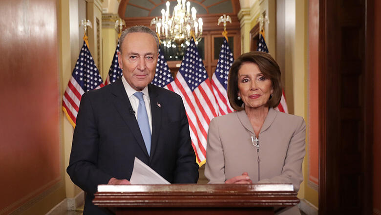 Speaker of the House Nancy Pelosi (D-CA) (R) and Senate Minority Leader Charles Schumer (D-NY) pose for photographs after delivering a televised response to President Donald Trump's national address about border security at the U.S. Capitol