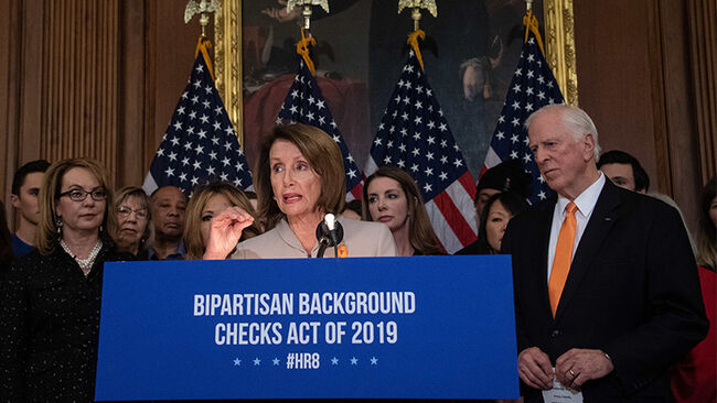 US House Speaker Nancy Pelosi holds a press conference with former Rep. Gabrielle Giffords (L) and Democratic Representative from California Mike Thompson (R) to introduce legislation on expanding background checks for gun sales at the Capitol in Washington, DC