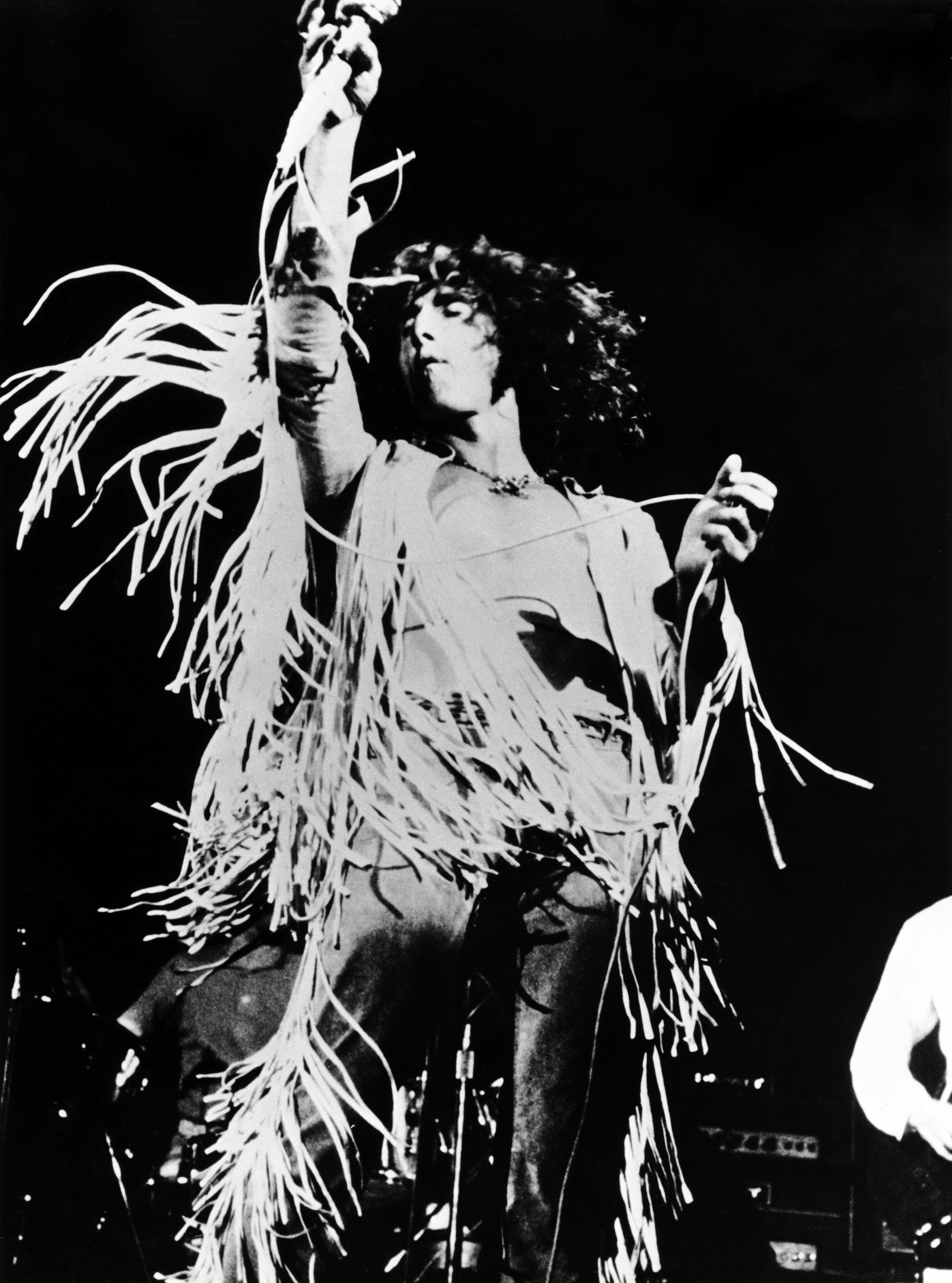 The Who's Roger Daltrey performing at Woodstock in 1969