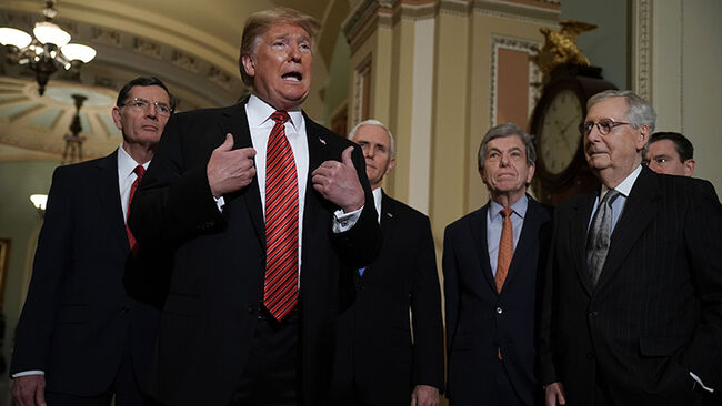 U.S. President Donald Trump (2nd L) speaks to members of the media as (L-R) Sen. John Barrasso (R-WY), Vice President Mike Pence, Sen. Roy Blunt (R-MO), and Senate Majority Leader Sen. Mitch McConnell (R-KY) listen at the U.S. Capitol after the weekly Republican Senate policy luncheon