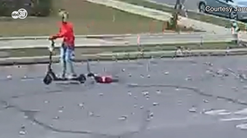 Qui West - Woman On Motorized Scooter Drags Small Dog In California!