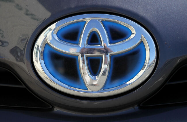 DALY CITY, CA - MAY 11: The Toyota logo is displayed on a brand new Toyota Prius on the sales lot at City Toyota May 11, 2010 in Daly City, California. Despite massive recalls of Toyota cars and trucks, Toyota reported a fiscal year profit of $2.2 billion. (Photo by Justin Sullivan/Getty Images)