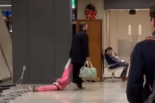 Exhausted Dad Drags Daughter Through Airport