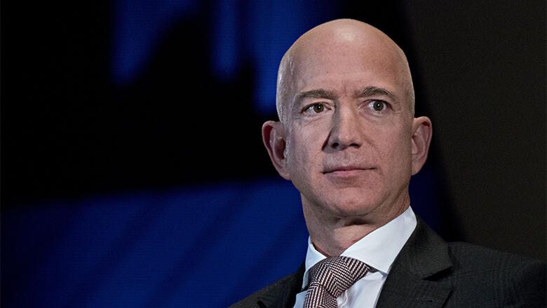 Jeff Bezos, founder and chief executive officer of Amazon.com Inc., listens during an Economic Club of Washington discussion in Washington, D.C.