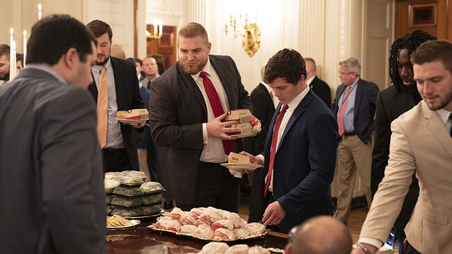 Members of the Clemson Tigers football team prepare to dine on fast food served by President Trump to celebrate their Championship at the White House