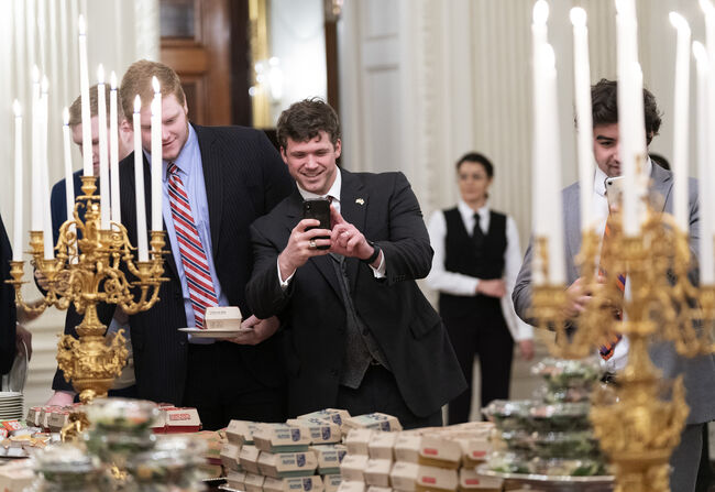 President Trump Hosts College Football Champion Clemson Tigers At White House WASHINGTON, DC - JANUARY 14: (AFP OUT) Members of the Clemson Tigers football team prepare to dine on fast food served by President Trump to celebrate their Championship at the White House on January 14, 2019 in Washington, DC. (Photo by Chris Kleponis-Pool/Getty Images)