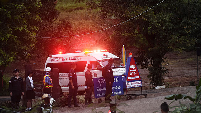 An ambulance leaves the Tham Luang cave area after divers evacuated some of the 12 boys and their coach trapped at the cave in Khun Nam Nang Non Forest Park in the Mae Sai district of Chiang Rai province