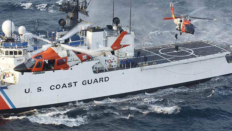 In this handout image provided by the U.S. Coast Guard, a Coast Guard maritime security force practices fast-roping to the Coast Guard cutter Seneca's flight deck