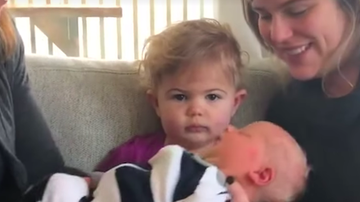 iHeartCountry Trending - Toddler Is Not Pleased By Her Little Brother