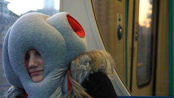 Lucy Lugnut - This Exists: New 'Ostrich Pillow' For On-The-Go Sleepers